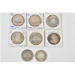 Eight Canadian silver dollar coins including 1951, 1953, two 1958, 196s, 1964 and two 1966