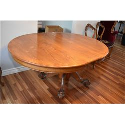 Antique round oak center pedestal dining table with one leaf