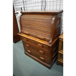 Unusual antique roll top desk with fitted interior, pull out writing surface and three drawers in ba