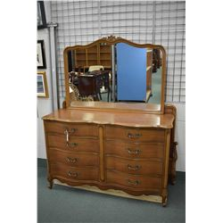 Three piece French provincial bedroom suite including five drawer highboy, eight drawer mirrored dre