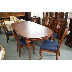 Quality solid cherry dining table with two large insert leaves and full sized protector/silencer pad