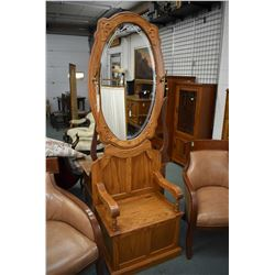 Modern oak hall seat with mirrored back and coat hooks complete with flip seat storage area