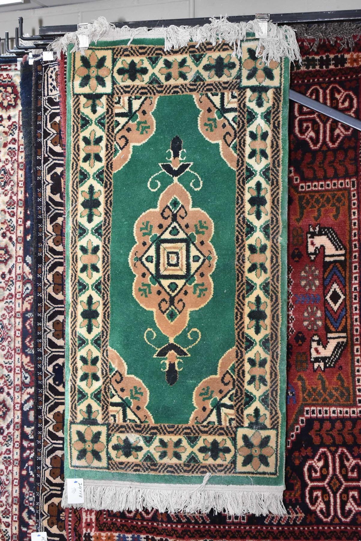 Picture of: Small Wool Scatter Rug With Emerald Green Back And Center Medallion With Taupe And Black Highlights