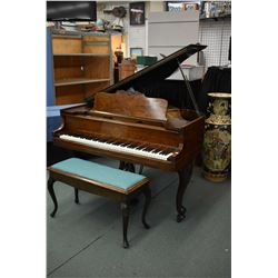 Antique baby grand piano with decorative exotic wood and ivory keys made by Julien Quidoz Pianos, St