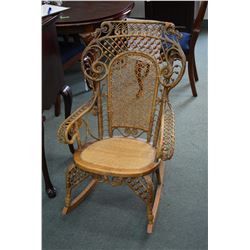 Elegant antique caned wicker rocking chair