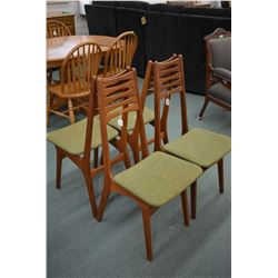 Set of four mid century modern teak framed dining chairs with upholstered seats