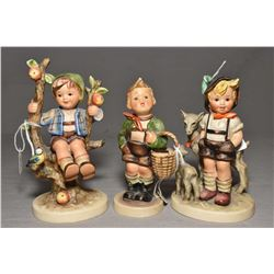 Three Goebel Hummel figurines including apple tree boy, Peter the goat herd and a boy with basket