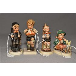 Four small Hummel figurines including singing lesson, chimney sweep, happy wanderer and little drumm