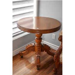 Antique walnut center pedestal occasional table with simulated wooden rivet design