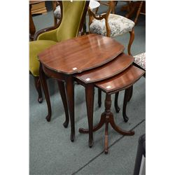 Three pieces mahogany set of French provincial nesting tables made by Baetz
