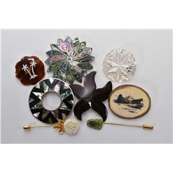Selection of vintage brooches, all made of natural materials including scrimshaw bone, shell, mother