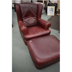 Large oxblood upholstered wing chair and matching ottoman