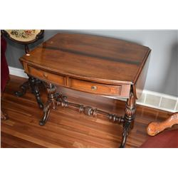 Antique mahogany drop leaf occasional table with two drawers and turned reeded supports and stretche