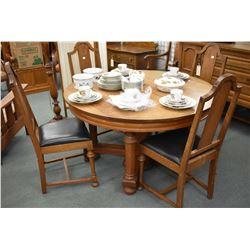 "Antique quarter cut oak 50"" round dining table with split pedestal base, extends large enough to exc"