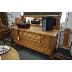 Antique quarter cut oak sideboard with three drawer, two doors, mirrored backboard and original key