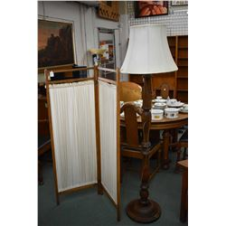 Antique turned wooden floor lamp and a two panel oak framed and fabric room divider/privacy screen