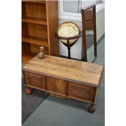 Vintage flip top storage chest and a semi contemporary floor standing world globe
