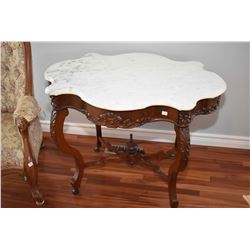 Antique mahogany parlour table with carved support and skirt, crossed stretchers with finial, fitted