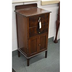 Antique mahogany music cabinet with four tilting drawers and cupboard storage area