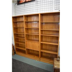 Two piece mid century modern teak wall unit with multiple adjustable shelves and two sliding doors,
