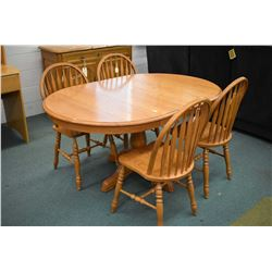 Canadian made semi contemporary center pedestal round oak dining table with two skirted insert leave