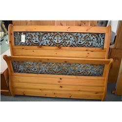 Modern Queen sized pine sleigh with inset cast decoration with headboard, foot board and rails