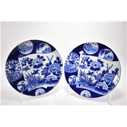 Two matching antique Japanese chargers depicting multiple hand painted plates, note one with repair,