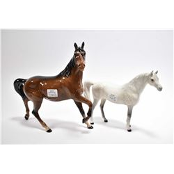 "Two Beswick porcelain horses including a brown mare 8 1/2"" in height"