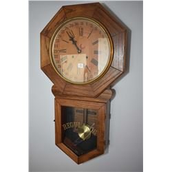 "Antique oak cased Seth Thomas ""Regulator"" wall clock with original paper labelling"