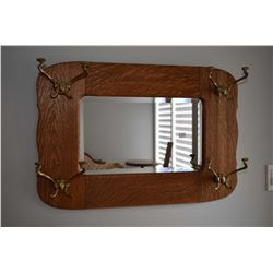Antique bevelled wall mirror with brass coat hooks in quarter cut oak frame