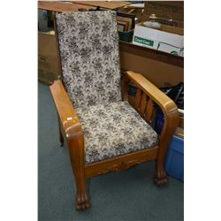Antique oak reclining Morris chair with carved paw feet and tapestry upholstery