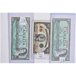 Two 1954 Canadian one dollar bills each containing Lawson and Bouey signatures plus a 1923 Dominion