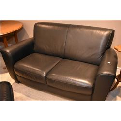Three piece dark colour leather or leather like parlour suite including sofa, loveseat and ottoman