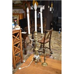 Small three branch brass candlestick and a tall three branch candle motif electric lamp