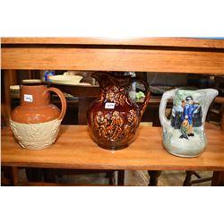 Three jugs including Majolica style Arthur Wood jug, figural salt glazed jug etc.