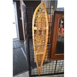 Pair of wooden snow shoes
