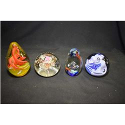 Four glass paperweights including one signed by artist