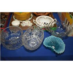 Two crystal bowls, one pressed glass double handled bowl and a blue ruffled bowl