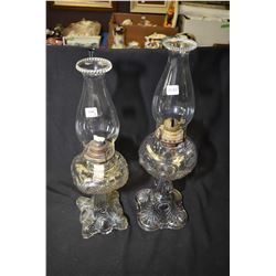 Two pressed glass colourless Canadian oil lamps with chimneys