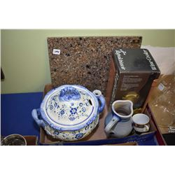 Selection of kitchen items including lidded tureen, ceramic pitcher, cutting board, Italian wine coo