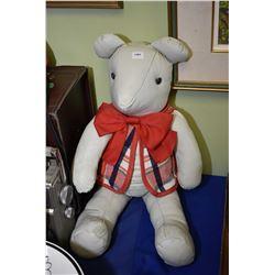Leather stuffed teddy bear in vest made by Gnarley Bones