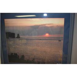 Framed print of a photograph of an ocean sunset signed Leonard