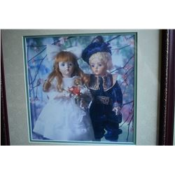 """Two framed prints including Besse Gutmann """"Awakening"""" and a framed print of A. Marques dolls"""
