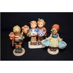 Three Hummel/Goebel figurines including Mothers Darling, Little Scholar, etc