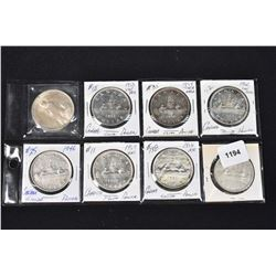 Seven Canadian silver dollars ranging 1953-66 and a 1922 American silver dollar