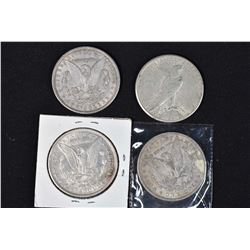 Four American silver dollars including two 1896, 1900 and 1922