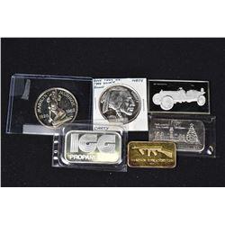 Six assorted sterling silver tokens/ingots including Thompson Sub Machine Gun, 1911 Marmon, Marilyn