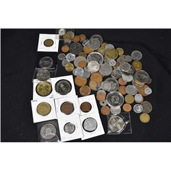 Large selection of coin-like tokens including a Wetaskiwin North AM dollar, 1978 Commonwealth Games,