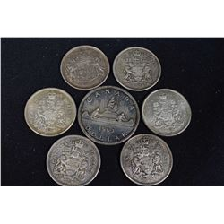 1963 Canadian silver dollar and six Canadian silver half dollars 1956 to 1965