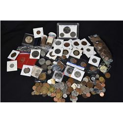 Large selection of mostly foreign coins including America, England, Mexico, etc